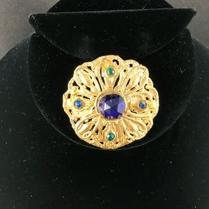 Vintage golden brooch with Blue and green stones